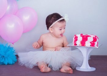https://www.pexels.com/photo/baby-in-white-tutu-skirt-beside-cake-206347/